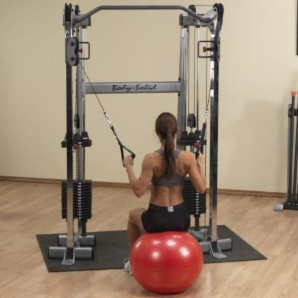 Woman Using A Gym Ball With Cables On The Body Solid GDCC210 In This Review