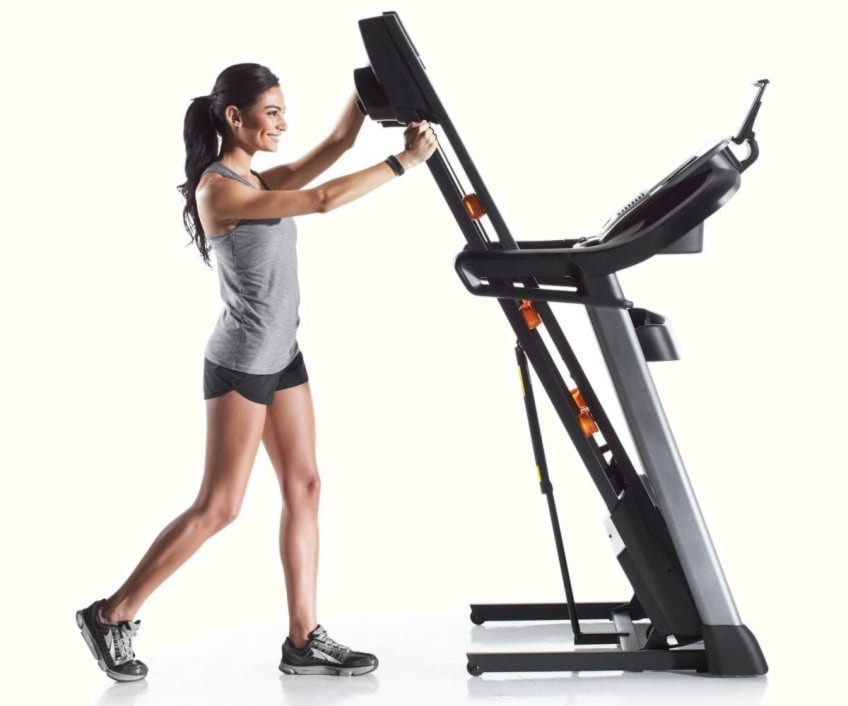 Woman Folding Treadmill Easily NordicTrack C1650 Top Rated For Home