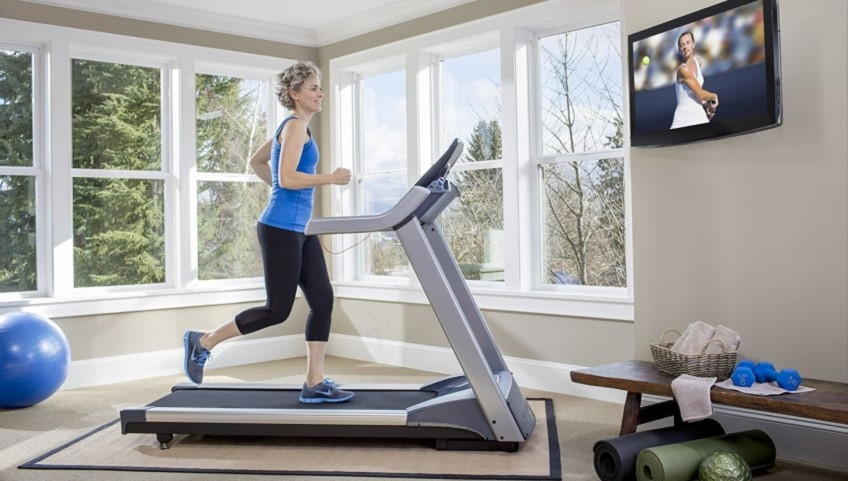 The Precor TRM 243 Energy Series Treadmill In a Home Gym